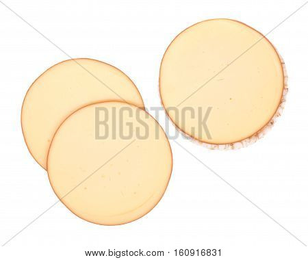 Sliced amish farm organic smoked gouda cheese and organic brown rice cake isolated on white background