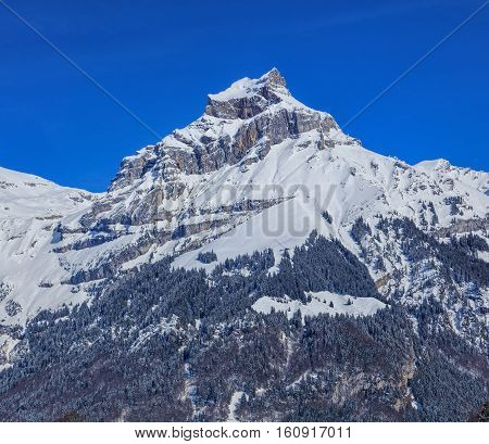 Mount Hahnen, view from the town of Engelberg in the Swiss Canton of Obwalden in winter. Hahnen is a mountain of the Uri Alps.