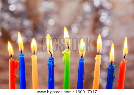 Jewish Holiday Menorah Beautiful Menorah With Burning Candles On Light Blurred Background.