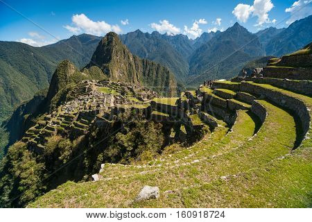 Machu Picchu, Peru - Oct 13, 2016: View of the Lost Incan City of Machu Picchu near Cusco Peru. Machu Picchu is a Peruvian Historical Sanctuary. Terraces can be seen on foreground.