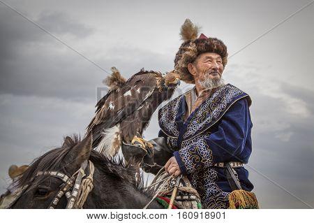 Eagle Hunter With His Altai Golden Eagle