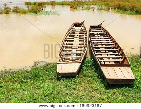 Scenic landscape of the ancient wooden boats on Lake Phayao Province, Thailand.