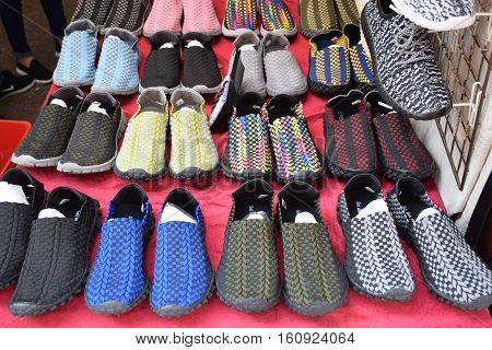Colorful pairs of shoes in a market stall in Hong Kong, China