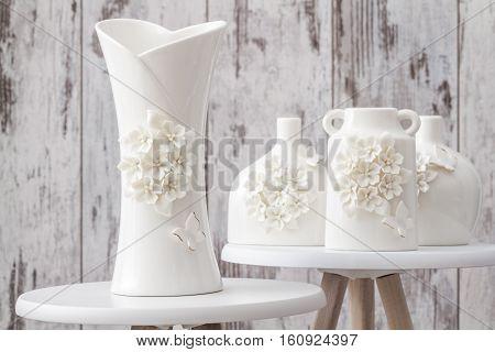 Different Decorative White Vases On White Background