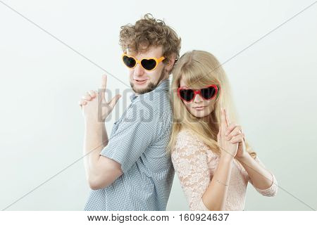 Couple Man And Woman Making Gun Gesture.