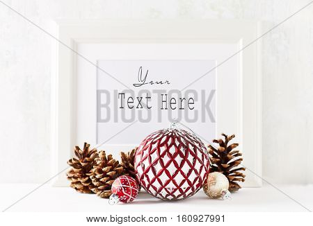 Rustic Christmas decorations and a white image frame