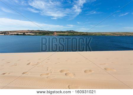 Footprint On White Sand Dune Desert And Lake In Mui Ne, Vietnam