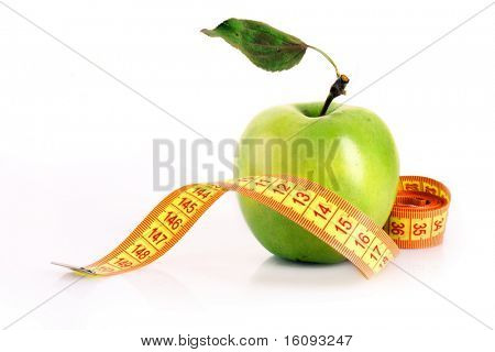 Fresh green tasty apple with measuring tape isolated on white