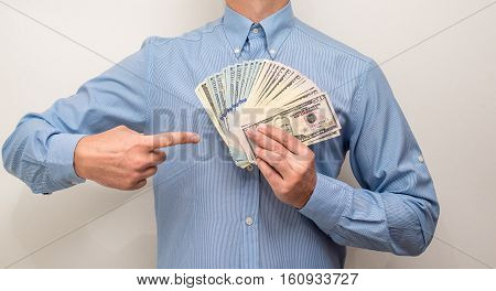 man holding a fan of the American currency