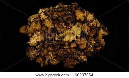 Chinese Herbal medicine ( Ligusticum chuanxiong Hort ) on black background