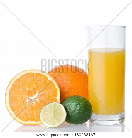 A Glass Of Fresh Orange Juice Is Isolated On A White Background. Orange And Lime.