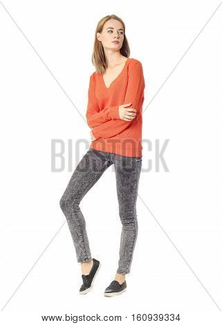 Young Brunette Girl Standing In Gray Skinny Jeans