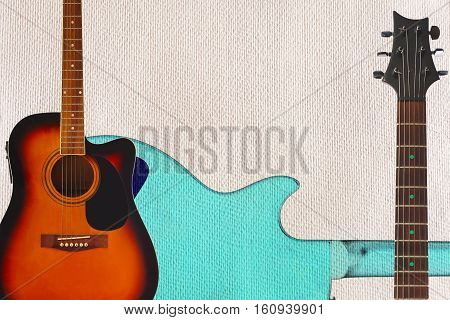 Acoustic guitar neck and back of guitar body on the cardboard background with plenty of copy space.
