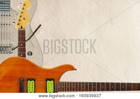 Mahogany and grey electric guitars and headstock on the rough cardboard background with plenty of copy space.