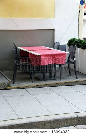 table in the restaurant on the sidewalk of the street