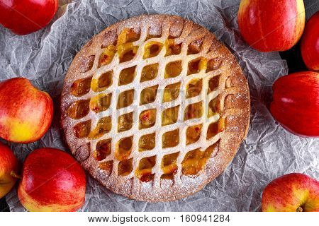 Home baked Lattice apple pie on black background.