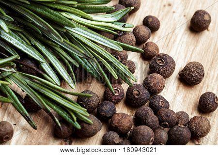 grains of black pepper on wood background. Black pepper peas