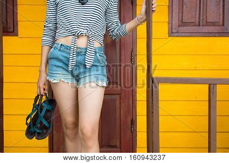 Girl Walking Out Of The Beach House