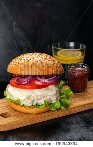 Fresh Homemade Burger With Chicken Cutlet, Tomato Sauce And Mozzarella Cheese