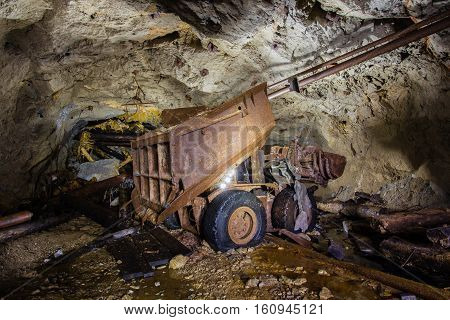 Abandoned old mine shaft ore loading machine tunnel passage