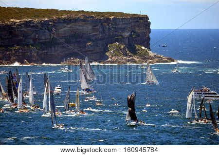 Sydney Australia - December 26 2013. Participant Yachts approaching North Head. The Sydney to Hobart Yacht Race is an annual event starting in Sydney on Boxing Day and finishing in Hobart.