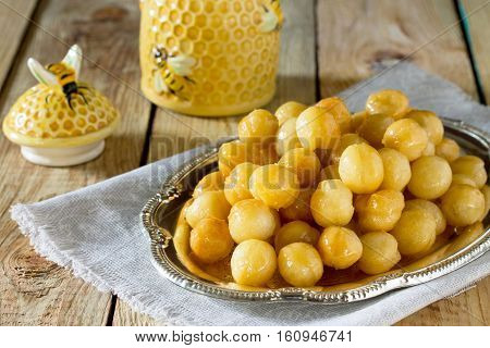 Loukoumades Donuts With Honey And Cinnamon. Hanukkah Celebration Concept. Copy Space.