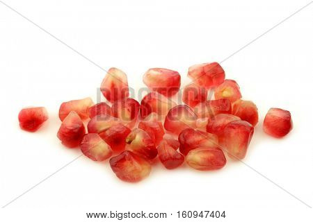 bunch of pomegranate seeds on a white background