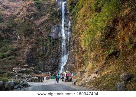 SIKKIM, INDIA - DECEMBER 03, 2016: Bhim Nala Waterfall also known as Amitabh Bachchan waterfall due to it's height is located on Lachung Road, Sikkim India.