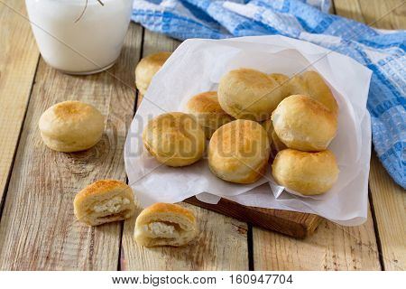 Doughnuts With Filling Sweet Cottage Cheese On A Wooden Background. The Concept Of Celebrating Chanu