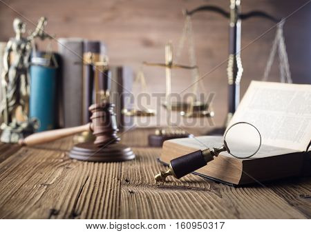 Law and justice concept - gavel of judge, legal code,Themis and scale of justice on wooden table