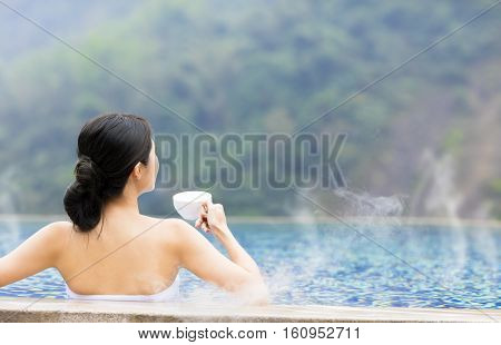 young asian woman relaxing in hot springs