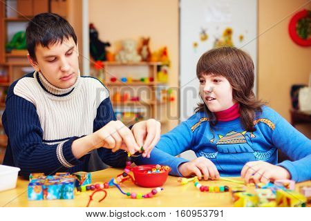 kids with special needs develop their fine motor skills in daycare rehabilitation center poster