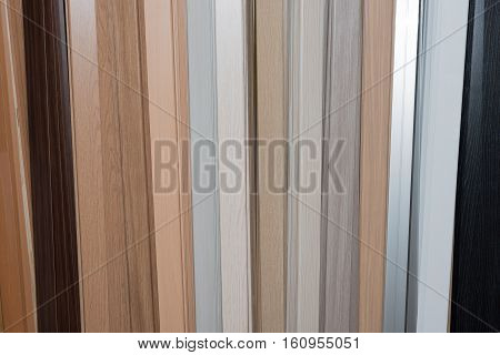 Set of wooden slats in different colors. Construction decorative finish inside the house.