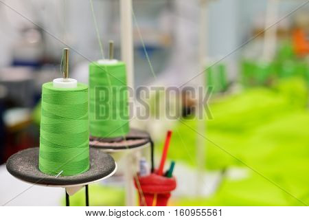 Spools of thread in the sewing equipment. The concept of sewing production.