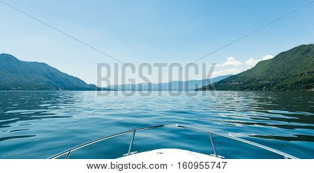 On the boat sail on Lake Como. Italy. Along the green mountains and the small Italian villages with red roofs.