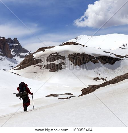 Hiker in snow mountains at sun spring day. Turkey Central Taurus Mountains Aladaglar (Anti-Taurus) plateau Edigel (Yedi Goller)