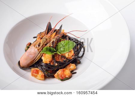 spaghetti with cuttlefish ink and langoustines black