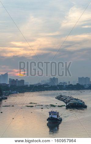 Tug Boat Cargo Ship In Chao Phraya River In Evening.