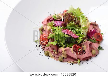 salad with roast beef tuna and anchovy sauce. Isolated