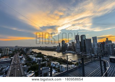 Sun setting over Brisbane City, view from the Story Bridge summit.