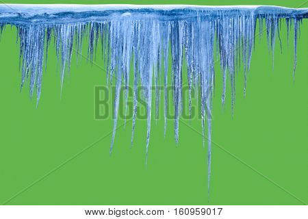 Icicles on an green background. Isolated object.