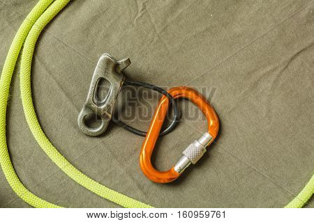 Belay Device, D-shaped Carabiner And Rope.