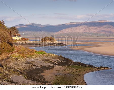 View from Picnic Island near Aberdovey up the Dyfi estuary. The Dyfi Estuary is located on the conjunction of the counties of Ceredigion Gwynedd and Powys. The area is designated a Special Protection Area (SPA) a protected site for wild birds under the EC