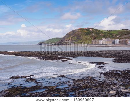 View of Aberystwyth on the Ceredigion coast Wales looking towards Constitution Hill together with the end of the Royal Pier.
