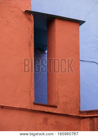 Typical combination of colours on a pair of buildings at Portmeirion Wales