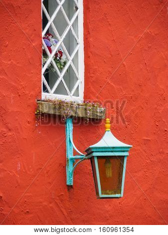 Colourful wall light and window Lady's Lodge Portmeirion Wales