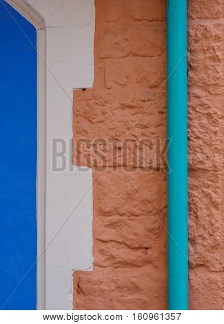 Colour combination of drainpipe archway and wall at Portmeirion Wales