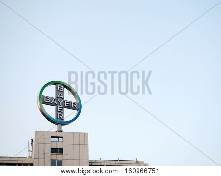 Big sign of Bayer company and part of the building against the sky in Berlin Germany