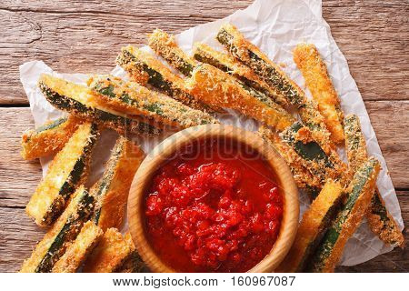 Zucchini Sticks In Breadcrumbs And Tomato Sauce Closeup. Horizontal Top View