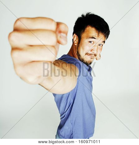 young cute asian man on white background gesturing emotional, pointing, smiling, lifestyle people concept, cheerfull mature guy close up
